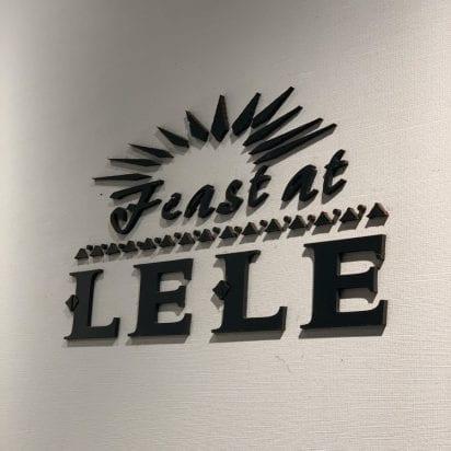 Feast at Lele Sign